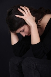 15832931 - woman having headache isolated on black