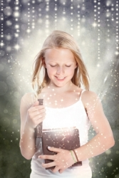 14396897 - happy young blonde girl opening a gift box