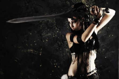 5614676 - beautiful female fighter with a sword in her hands.