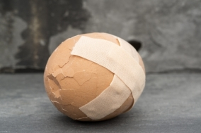 20330957 - sticking plaster on cracked egg broken healthcare concept image