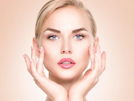 43728320 - beautiful spa girl touching her face. perfect fresh skin