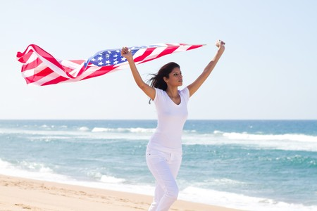 7085655 - woman running with usa flag on beach