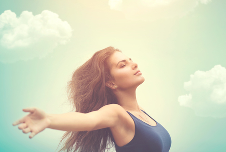 56329448 - free happy woman over sky and sun
