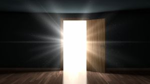 53285081 - light and particles in a dark room through the opening door