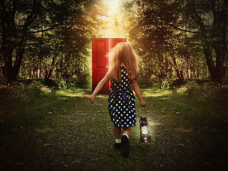 Child Walking in Woods to Glowing Red Door