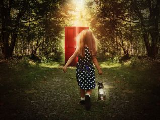 Child Walking in Woods to Glowing Red Door