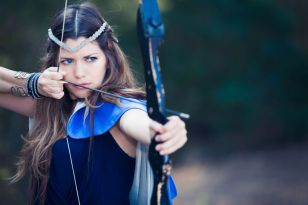28365465 - fictional forest hunter girl with bow and arrow