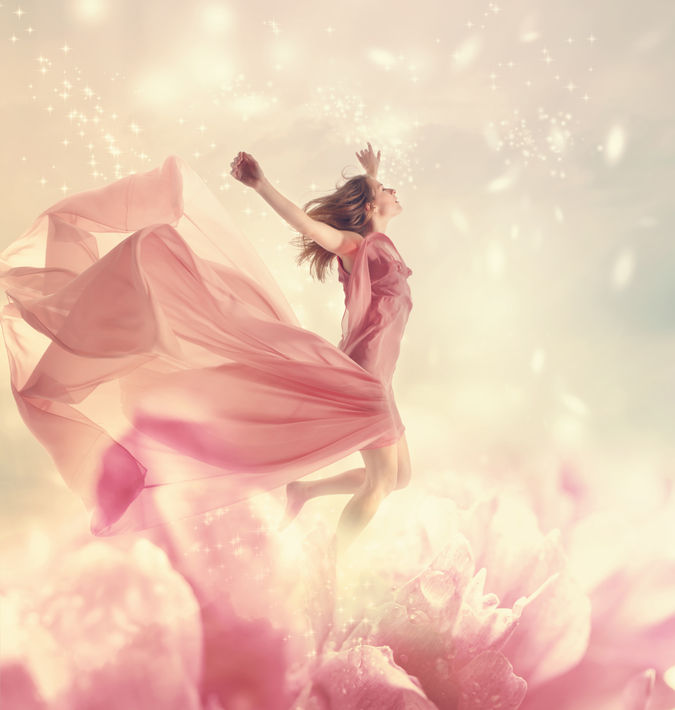 34683163 - beautiful young woman jumping on a giant flower